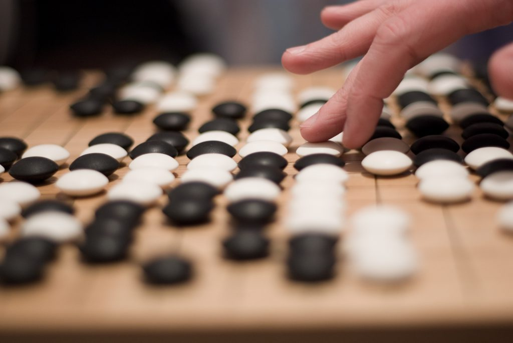Person playing Go board game